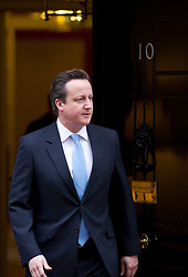 © Licensed to London News Pictures. 11/02/2013. London, UK. The British Prime Minister, David Cameron, is seen on the doorstep of Number 10 Downing Street as he prepares to meet with the Nigerian President Goodluck Jonathan in London today (11/02/13). The Downing Street visit came during a trip to Europe where Mr Jonathan also met with French President Francois Hollande to discuss the ongoing deployment of Nigerian and ECOWAS troops to Mali in support of the current military action against insurgents. Photo credit: Matt Cetti-Roberts/LNP