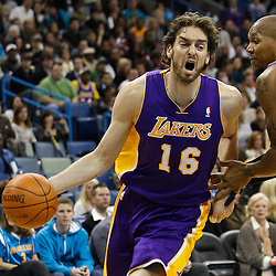 February 5, 2011; New Orleans, LA, USA; Los Angeles Lakers power forward Pau Gasol (16) drives past New Orleans Hornets power forward David West (30) during the first quarter at the New Orleans Arena.   Mandatory Credit: Derick E. Hingle