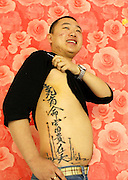 XI'AN, CHINA - CHINA OUT) <br /> <br /> Tattoo Like Beckham<br /> Li Xin shows his tattoo like one of David Beckham's tattoos on in Xi'an, Shaanxi Province of China. Beckham showed his tattoo in Chinese lettering to fans during his visit to Peking University in Beijing. <br /> ©Yan Wenqing/Exclusivepix
