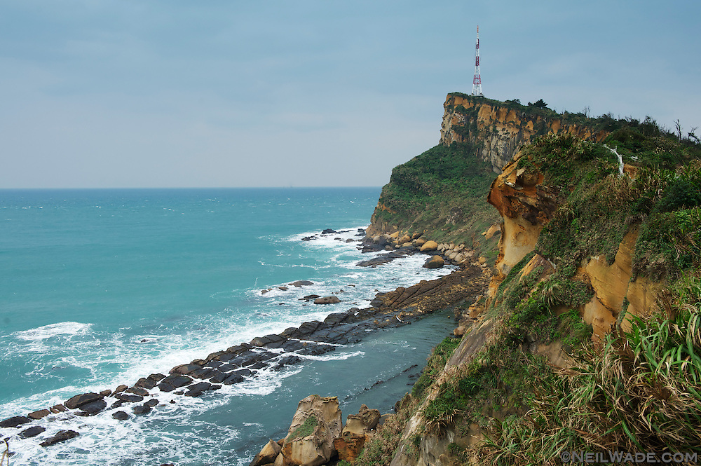 "The ""bean curd"" rocks can be seen below the Gueitou Mountain, out on the end of the peninsula.  The angled shape of the cliff is called ""cuesta"" and can be seen all over Taiwan."