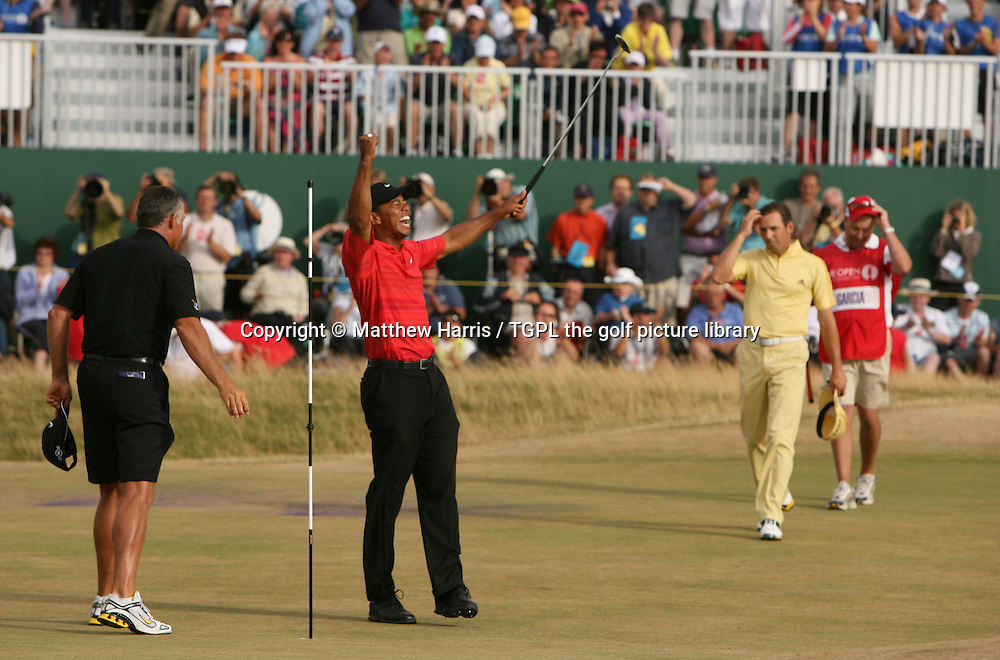 Tiger WOODS (USA) celebrates winning at 18th par 4 as Sergio GARCIA (ESP) looks on during fourth round The Open Championship 2006,Royal Liverpool, Hoylake, Wirral,England.