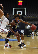24 MARCH 2009: Georgia Tech forward Deja Foster (23) tries to drive around Oklahoma guard/forward Nyeshia Stevenson (1) during an NCAA Women's Tournament basketball game Tuesday, March 24, 2009, at Carver-Hawkeye Arena in Iowa City, Iowa. Oklahoma defeated Georgia Tech 69-50.