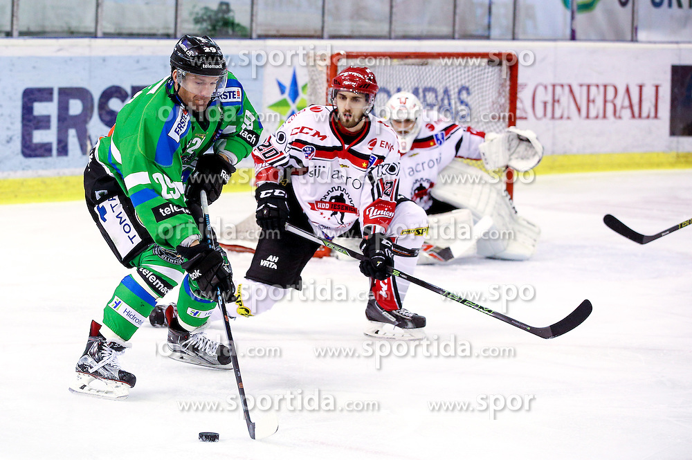 Anze Ropret of Olimpija and Marko Tarman of Jesenice during ice hockey match between HDD Telemach Olimpija and HDD SIJ Acroni Jesenice in Final of Slovenian League 2015/2016, on April 4, 2016 in Hala Tivoli, Ljubljana, Slovenia. Photo By Matic Klansek Velej / Sportida