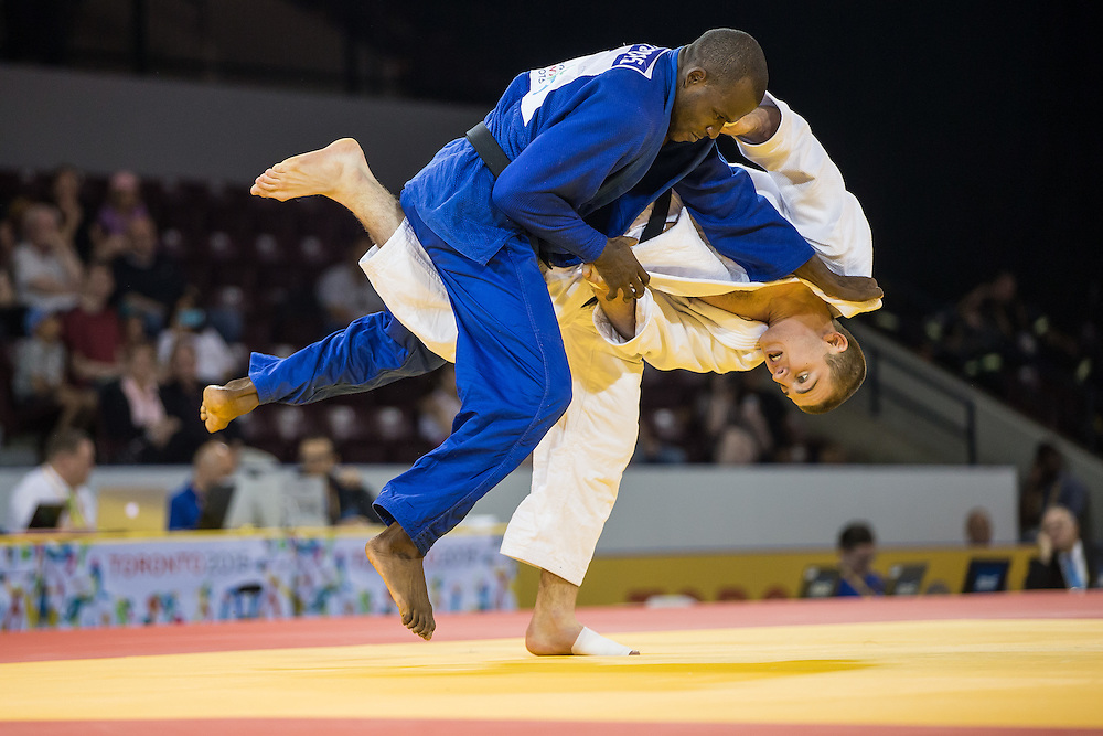 Pedro Castro (Top) of Colombia and Zachary Burt of Canada struggle for position during their bronze medal contest in the men's judo -81kg class at the 2015 Pan American Games in Toronto, Canada, July 13,  2015. AFP PHOTO/GEOFF ROBINS