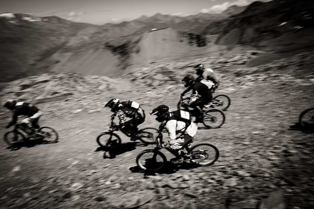 Riders descend during a heat, they can reach speeds of up to 90 kilometres per hour during the 25km course. Mountain of Hell race, held in Les Deux Alpes, France.