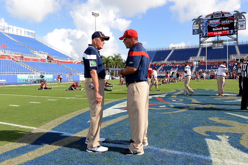 September 27, 2014: Head coach Larry Coker of the Roadrunners chats with head coach Charlie Partridge of the Owls before the football game between the Texas - San Antonio Roadrunners and Florida Atlantic Owls at Howard Schnellenberger Field in Boca Raton, FL. The Owls defeated the Roadrunners 41-31.