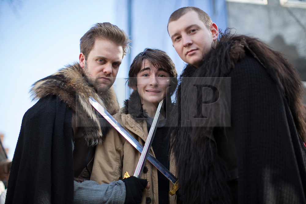 © licensed to London News Pictures. London, UK 04/03/2013. Isaac Hempstead Wright, who plays Bran Stark in Game of Thrones HBO show, posing with fans as he helps to promote show's Season 2 DVD launch with Game of Thrones food wagon in central London. Photo credit: Tolga Akmen/LNP