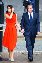 © Licensed to London News Pictures. 07/10/2015. Manchester, UK. SAMANTHA CAMERON and Prime Minister DAVID CAMERON arriving Conservative Party Conference at Manchester Central convention centre on Wednesday, 7 October 2015. Photo credit: Tolga Akmen/LNP