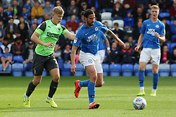 George Boyd of Peterborough United in action with Max Sanders of AFC Wimbledon - Mandatory by-line: Joe Dent/JMP - 28/09/2019 - FOOTBALL - Weston Homes Stadium - Peterborough, England - Peterborough United v AFC Wimbledon - Sky Bet League One