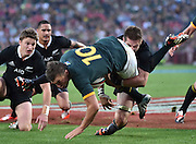 JOHANNESBURG, South Africa, 04 October 2014 : Richie McCaw (C) of the All Blacks tries to hold Handré Pollard of the Springboks away from the try line for his second try during the Castle Lager Rugby Championship test match between SOUTH AFRICA and NEW ZEALAND at ELLIS PARK in Johannesburg, South Africa on 04 October 2014. <br /> The Springboks won 27-25 but the All Blacks successfully defended the 2014 Championship trophy.<br /> <br /> © Anton de Villiers / SASPA