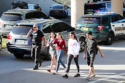 Teens who just walked out from the direction of the high school are escorted by police south on Coral Springs Drive and the Sawgrass Expressway just south of the campus of Stoneman Douglas High School in Parkland, FL, USA, after a shooting on Wednesday, February 14, 2018. Photo by Amy Beth Bennett/Sun Sentinel/TNS/ABACAPRESS.COM