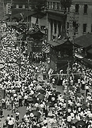 Asano Kiichi<br /> 1914 - 1993<br /> <br /> Kyoto's Gion Festival, 1950s<br /> <br /> Vintage gelatin silver print with blue studio stamp and Asano's red hanko stamp on the reverse.<br /> <br /> Size 4 3/4 in. x 6 1/2 in. (120 mm x 165 mm). <br /> <br /> Condition very good.<br /> <br /> Price ¥90,000<br /> <br /> <br /> <br /> <br /> <br /> <br /> <br /> <br /> <br /> <br /> <br /> <br /> <br /> <br /> <br /> <br /> <br /> <br /> <br /> <br /> <br /> <br /> <br /> <br /> <br /> <br /> .