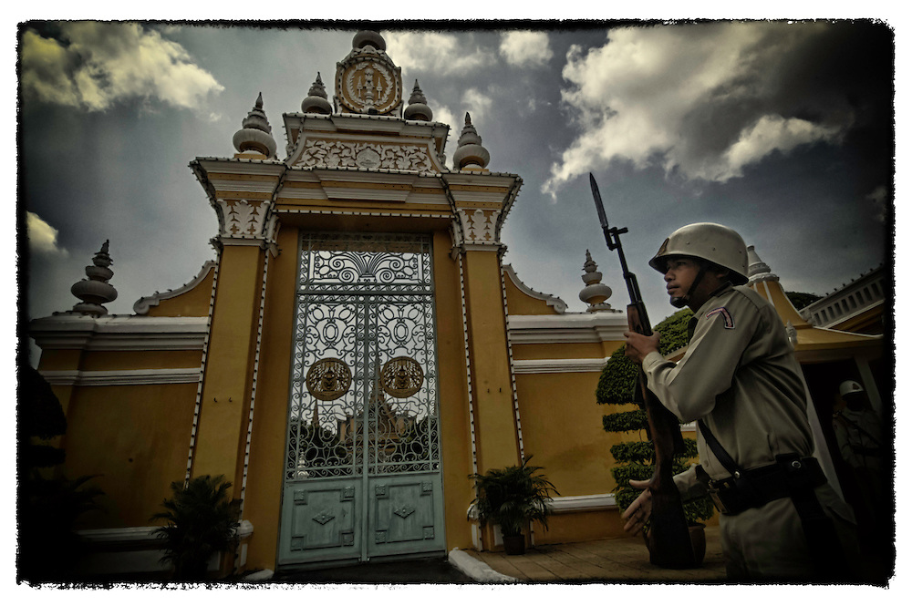 A soldier stands guard outside the Royal Palace in Phnom Penh, Cambodia.