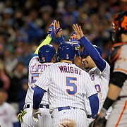 NEW YORK, NEW YORK - APRIL 29:  Yoenis Cespedes #52 of the New York Mets is congratulated by team mates after hitting a grand slam home run during the New York Mets twelve run third inning as Buster Posey #28 of the San Francisco Giants looks on during the New York Mets Vs San Francisco Giants MLB regular season game at Citi Field on April 29, 2016 in New York City. (Photo by Tim Clayton/Corbis via Getty Images)