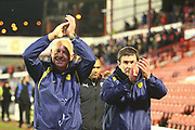 Burton Albion's manager Nigel Clough and Burton Albion's coach Andy Garner celebrate and applaud the Brewers fans after the final whistle during the EFL Sky Bet Championship match between Barnsley and Burton Albion at Oakwell, Barnsley, England on 20 February 2018. Picture by John Potts.