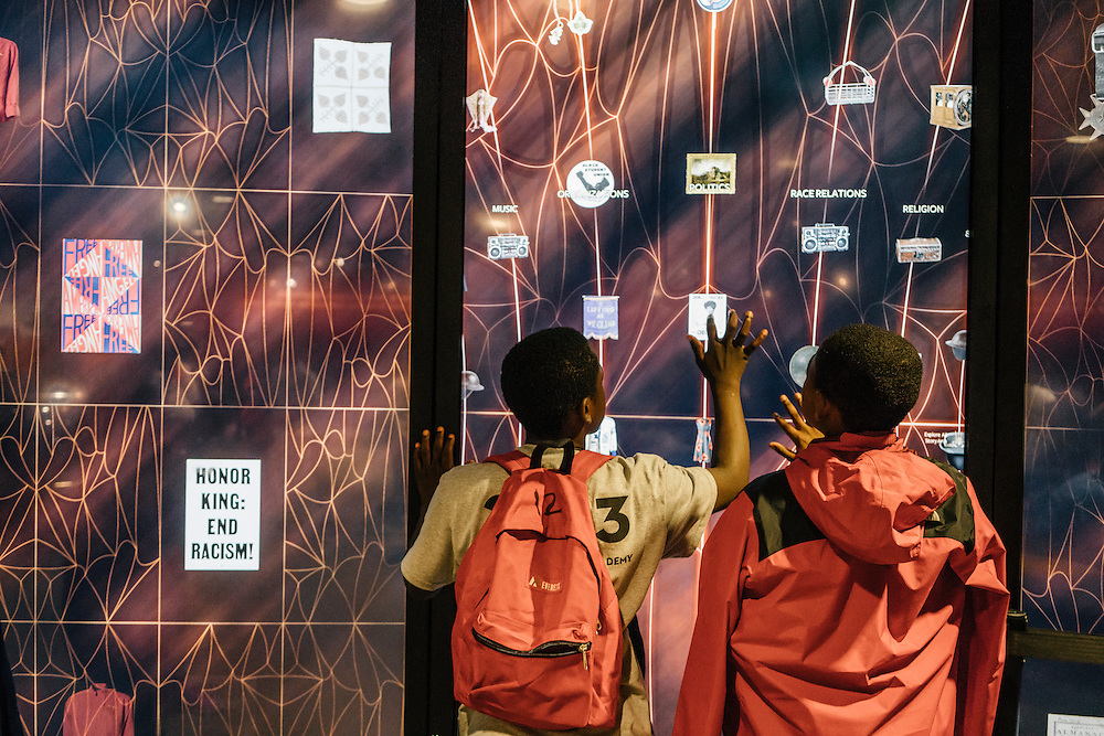 Sixth-graders from Knowledge Is Power Program (KIPP) DC, including Tay'sean Barrow, 12, left, and Omari Sterling, 11, right, look at exhibits inside the Smithsonian National Musuem of African American History and Culture during their visit on Oct 21, 2016. The students spent an hour touring the new Washington, D.C. museum, which is only available to see with reserved tickets during the first year.