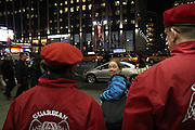 Manhattan, N.Y. November 15, 2013. A pedestrian eyes several Guardian Angels gathered outside the Pennsylvania Hotel, across from Madison Square Garden. 11/15/2013. Photo by Paul McCaffrey/NYCity Photo Wire