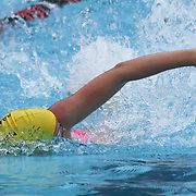 Swimmer Julia Snavely (17) competes in the 100 meter freestyle during the Summer Swim league championships finials Saturday, July. 17, 2015 at Western YMCA in Wilmington, DEL