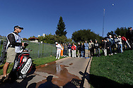 Ricky Fowler hits an approach shot from the walkway on hole 3 during Round 3 of the 2011 Chevron World Challenge at the Sherwood Country Club in Thousand Oaks, Calif., on Saturday,  Dec. 3, 2011.