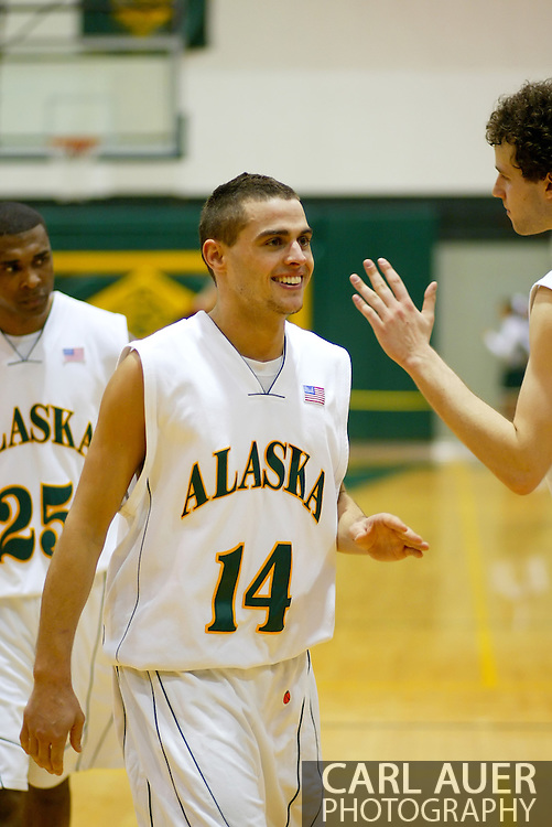 1/13/2006: Junior guard Luke Cooper (14) of the UAA Seawolves celebrates a Alaska Anchorage a comeback victory over Northwest Nazarene, 60-57, in men?s basketball action at the Wells Fargo Sports Complex on Saturday.