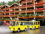 """Small electric taxis serve Zermatt, which bars combustion-engine cars to help preserve small village atmosphere and prevent air pollution. The famous mountaineering and ski resort of Zermatt lies at 1620 meters or 5310 feet elevation at the head of Mattertal (Matter Valley) in Valais canton, Switzerland, the Pennine Alps, Europe. The German word matten means """"alpine meadows."""" Most visitors reach Zermatt by cog railway train from the nearby town of Täsch (Zermatt shuttle). Trains also depart for Zermatt from farther down the valley at Visp and Brig on the main Swiss rail network. Hike the High Route (Chamonix-Zermatt Haute Route) for exceptional mountain scenery."""