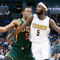 20 November 2016: Denver Nuggets guard Will Barton (5) drives past Utah Jazz guard Rodney Hood (5) during the Denver Nuggets 105-91 victory over the Utah Jazz, at the Pepsi Center, Denver, Colorado, USA.