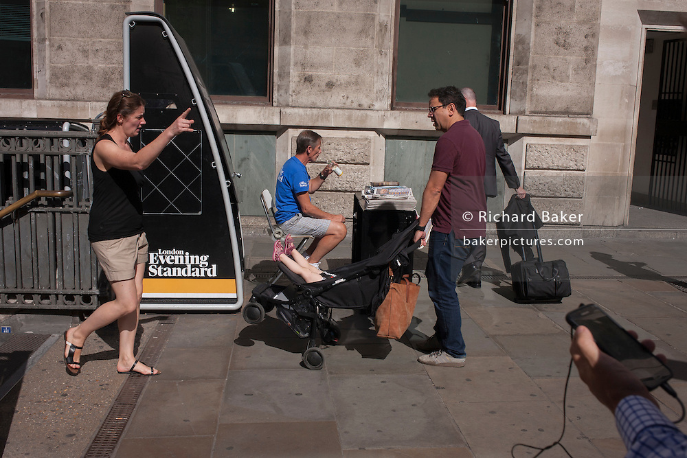 Two parents have struggled up the steps of Bank Undeground station in the City of London.