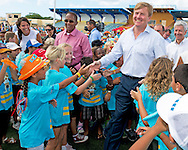 21-11-2013 ARUBA – ORANJESTAD - King Willem Alexander of the Netherlands and Queen Maxima at Aruba . Sporting stadium in Guillermo Trinidad They will visit all the 6 Dutch Islands. The royal couple will visit the Caribbean . COPYRIGHT ROBIN UTRECHT