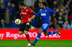 Cardiff Forward Tommy Smith (ENG) attacks down the wing as Watford Midfielder Ikechi Anya (SCO) defends during the second half of the match - Photo mandatory by-line: Rogan Thomson/JMP - Tel: Mobile: 07966 386802 23/10/2012 - SPORT - FOOTBALL - Cardiff City Stadium - Cardiff. Cardiff City v Watford - Football League Championship