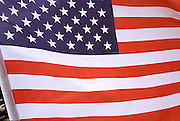 Detail of American flag waving in the wind