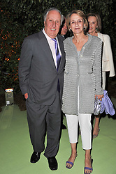 FREDERICK & SANDY FORSYTH at a dinner hosted by Cartier in celebration of the Chelsea Flower Show held at Battersea Power Station, 188 Kirtling Street, London SW8 on 23rd May 2011.