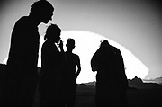 Silhouettes of four people at sunset in Middle East Tek, Wadi Rum, Jordan