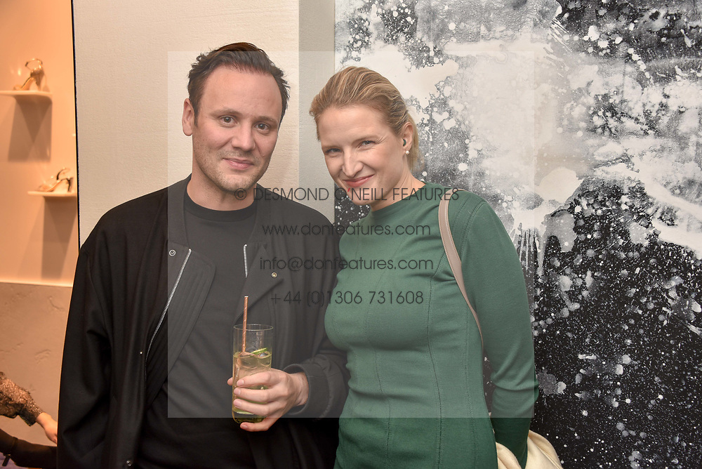 Nicholas Kirkwood and Fiona Scarry at a party hosted by Nicholas Kirkwood and Eva Fehren to celebrate Part 2 in the Nicholas Kirkwood presents series held at Nicholas Kirkwood, 5 Mount Street, London England. Eva Fehren is a fine jeweller, born and raised in New York City. Her collections are both inspired and created in the city, and via the Nicholas Kirkwood store, it is the first opportunity to view and shop the collection in London. 9 November 2017.