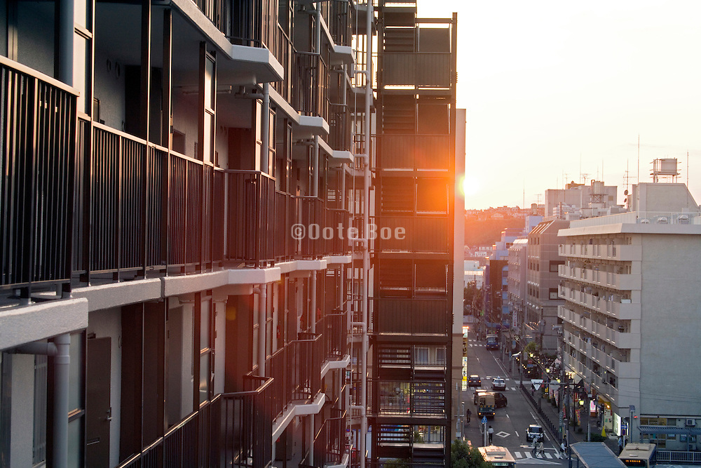 residential high rise apartment building n Yokohama Japan at sunset