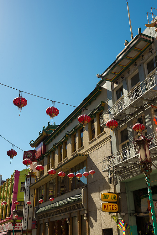 Unique architecture of Chinatown San Francisco with red lanterns hanging over the street