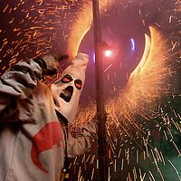 Correfoc, a catalan traditional street feast run in the streets under firecrackers and flames.