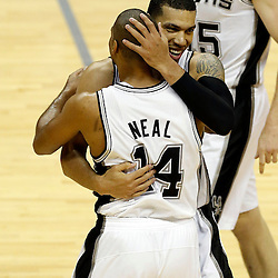 Jun 11, 2013; San Antonio, TX, USA; San Antonio Spurs shooting guard Danny Green (4) hugs San Antonio Spurs point guard Gary Neal (14) against the Miami Heat in the second quarter during game three of the 2013 NBA Finals at the AT&T Center. Mandatory Credit: Derick E. Hingle-USA TODAY Sports