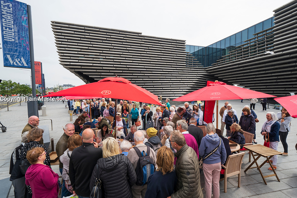 Dundee, Scotland, UK. 23 June 2019. The BBC Antiques Roadshow TV programme is aiming on location t the new V&A Museum in Dundee today. Long queues formed as members of the public arrived with their collectables to have them appraised and valued by the Antiques Roadshow experts. Select items and their owners were chosen to be filmed for the show.