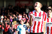 Danny Wright celebrates after scoring his second for Cheltenham during the Vanarama National League match between Cheltenham Town and Boreham Wood at Whaddon Road, Cheltenham, England on 25 March 2016. Photo by Carl Hewlett.