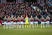 Burnley players during the minutes appreciation for Ian Britton before the Sky Bet Championship match between Burnley and Cardiff City at Turf Moor, Burnley, England on 5 April 2016. Photo by Simon Brady.