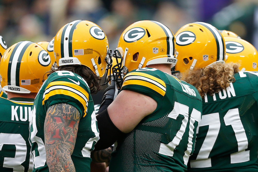 GREEN BAY, WI - DECEMBER 2:  Offense of the Green Bay Packers huddle before a game against the Minnesota Vikings at Lambeau Field on December 2, 2012 in Green Bay, Wisconsin.  The Packers defeated the Vikings 23-14.  (Photo by Wesley Hitt/Getty Images) *** Local Caption ***