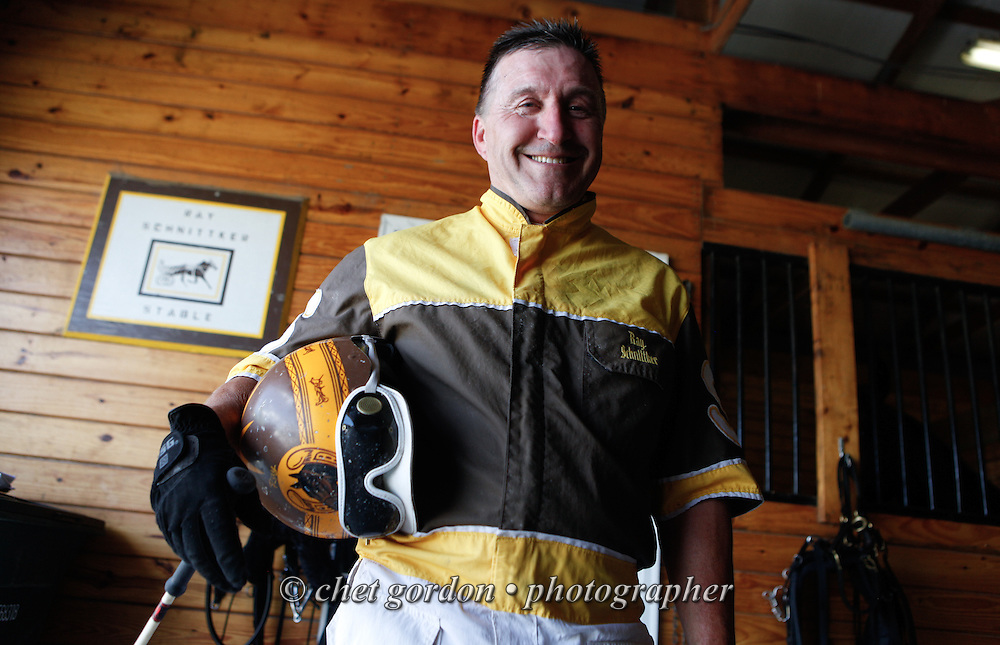 Ray Schnittker pauses for a portrait in his stables during the second day of harness racing at the Goshen Historic Track in Goshen, NY on Friday, July 5, 2013.