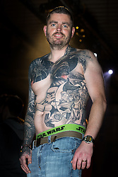 "© Licensed to London News Pictures . 06/12/2015 . Manchester , UK . NEIL PARRY (40 from Mold in N Wales) with his extensive Star Wars tattoos . Fans attend Star Wars exhibition "" For the Love of the Force "" at Bowlers Exhibition Centre in Manchester . Photo credit : Joel Goodman/LNP"