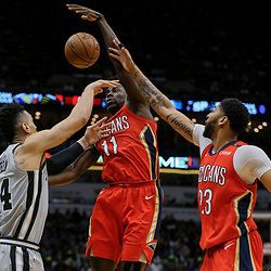 Apr 11, 2018; New Orleans, LA, USA; New Orleans Pelicans guard Jrue Holiday (11) and forward Anthony Davis (23) defend San Antonio Spurs guard Danny Green (14) during the second half at the Smoothie King Center. The Pelicans defeated the Spurs 122-98. Mandatory Credit: Derick E. Hingle-USA TODAY Sports