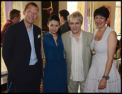 Duran Duran band Member Nick Rhodes with his Girlfriend Nefer Suvio (centre) and Nat Rothschild (left) and Ghislaine Maxwell (right) attend the National Youth Orchestra of The United States of America Reception at the <br /> The Royal Albert Hall hosted be Ronald O.Perelman, London, United Kingdom,<br /> Sunday, 21st July 2013<br /> Picture by Andrew Parsons / i-Images