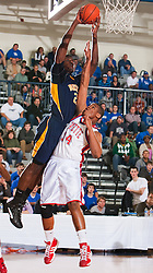 Northeast's Alex Poythress, left, dunk over Lafayette's Shon Wright in the first half. Lafayette hosted Northeast (TN)  Saturday, Jan. 07, 2012 at Lexington Catholic Gym in Lexington.