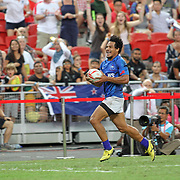 With time expired, Tila Mealoi, scores the winning try to beat the New Zealand All Black 7's 26-21, earning the Plate Final at the HSBC Singapore 7's, day 2, Singapore National Stadium, Singapore.  Photo by Barry Markowitz, 4/17/16