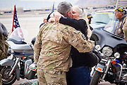 """15 JANUARY 2012 - PHOENIX, AZ:    Homecoming soldiers greet their family members at the The 161st Air Refueling Wing of the Arizona Air National Guard in Phoenix. About 100 soldiers of A (Alpha) Company of the 422nd Expeditionary Signal Battalion (referred to as """"Alpha 4-2-2"""") of the Arizona Army National Guard returned to Arizona on Sunday, Jan. 15, following a nearly year-long deployment to Afghanistan. More than 10,000 Arizona Army and Air National Guard Soldiers and Airmen have been ordered to federal active duty in support of Operations Noble Eagle, Enduring Freedom, Iraqi Freedom, and New Dawn since September 2001. Approximately 200 Arizona National Guard Soldiers and Airmen are still serving on federal active duty overseas.  PHOTO BY JACK KURTZ"""