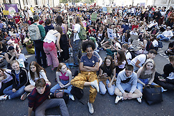 © Licensed to London News Pictures. 20/09/2019. London, UK. Activists taking part in the Global Climate Strike demonstration sit down in the road near Trafalgar Square. Thousands of similar actions are taking place all over the UK and the rest of the world. Photo credit: Peter Macdiarmid/LNP