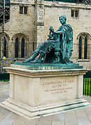 """This statue outside of York Minster honors Constantine the Great(or Saint Constantine, AD 274- 337)who was proclaimed Roman Emperor in York in AD 306. York is in North Yorkshire, England, United Kingdom, Europe. Constantine was aRoman EmperorofIllyrian-Greekorigin from 306 to 337. While campaigning under his father inBritannia(Britain), Constantine was acclaimed as emperor by the army atEboracum(modern-dayYork) after his father's death in 306AD. He emerged victorious in a series of civil wars against EmperorsMaxentiusandLiciniusto become sole ruler of both west and east by 324AD. Among his many major reforms, Constantine separated thecivilandmilitaryauthorities. To combat inflation, he introduced a newgold coin, the solidus, the standard for Byzantine and European currencies for more than a thousand years. Constantine was the first Roman emperor toconverttoChristianity,and he played an influential role in the proclamation of theEdict of Milanin 313, which declared religious tolerance for Christianity in the Roman empire. He called theFirst Council of Nicaeain 325, at which theNicene Creedwas adopted by Christians. Constantine pursued successful campaigns against the tribes on the Roman frontiers—theFranks, theAlamanni, theGoths, and theSarmatians—even resettling territories abandoned by his predecessors during theCrisis of the Third Century. He built a new imperial residence atByzantiumand renamed the cityConstantinopleafter himself. It became the capital of the Empire for more than a thousand years, and the later Eastern Empire was known as theByzantine Empire. He replaced Diocletian'stetrarchywith the principle of dynastic succession by leaving the empire to his sons. He is venerated as a saint byEastern OrthodoxandByzantine Catholics. Historically, he has been called the """"First Christian Emperor"""" for his promotion of the Christian Church, but some modern scholars d"""